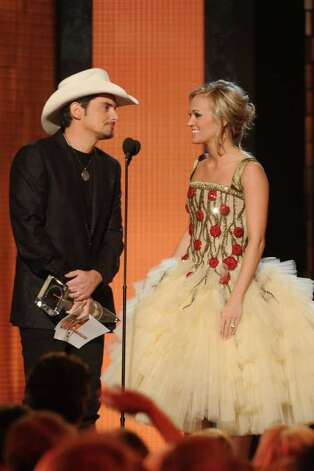 NASHVILLE, TN - NOVEMBER 10:  CMA Entertainer of the Year Brad Paisley and Carrie Underwood speak at the 44th Annual CMA Awards at the Bridgestone Arena on November 10, 2010 in Nashville, Tennessee.  (Photo by Rick Diamond/Getty Images) *** Local Caption *** Brad Paisley;Carrie Underwood Photo: Rick Diamond, Getty Images / 2010 Getty Images