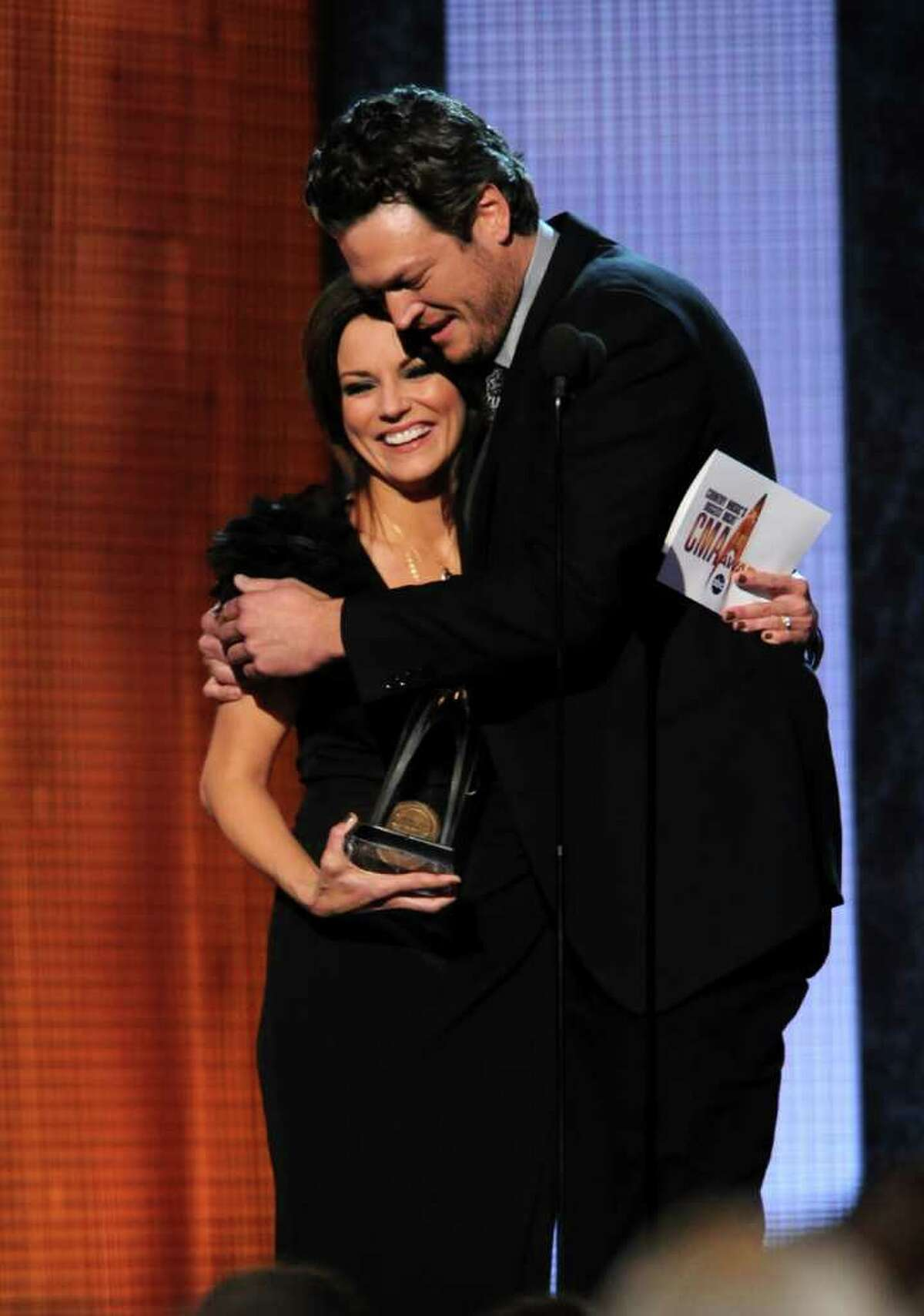 NASHVILLE, TN - NOVEMBER 10: Martina McBride presents award for Male Vocalist of the Year to Blake Shelton at the 44th Annual CMA Awards at the Bridgestone Arena on November 10, 2010 in Nashville, Tennessee. (Photo by Rick Diamond/Getty Images) *** Local Caption *** Martina McBride;Blake Shelton