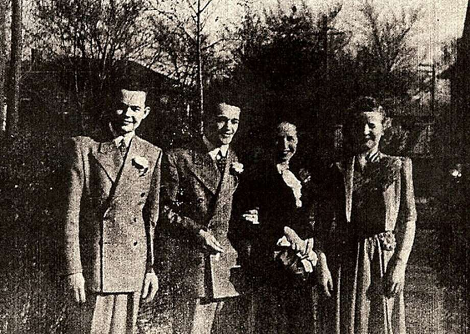 "Arthur H. ""Bud"" Kelder (left) with his brother Herman at Herman's wedding in 1940. Arthur's cousin John Eakin now is seeking the return of his remains from the Philippines."