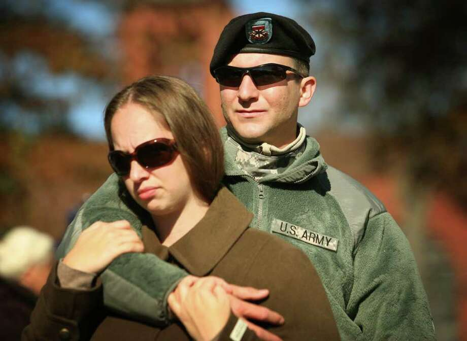 Active duty Iraq veteran Chris Jachimonski and his girlfriend Courtney Briggs, both of Derby, attend the Veteran's Day ceremony on the Derby Green on Thursday, November 11, 2010. Photo: Brian A. Pounds / Connecticut Post