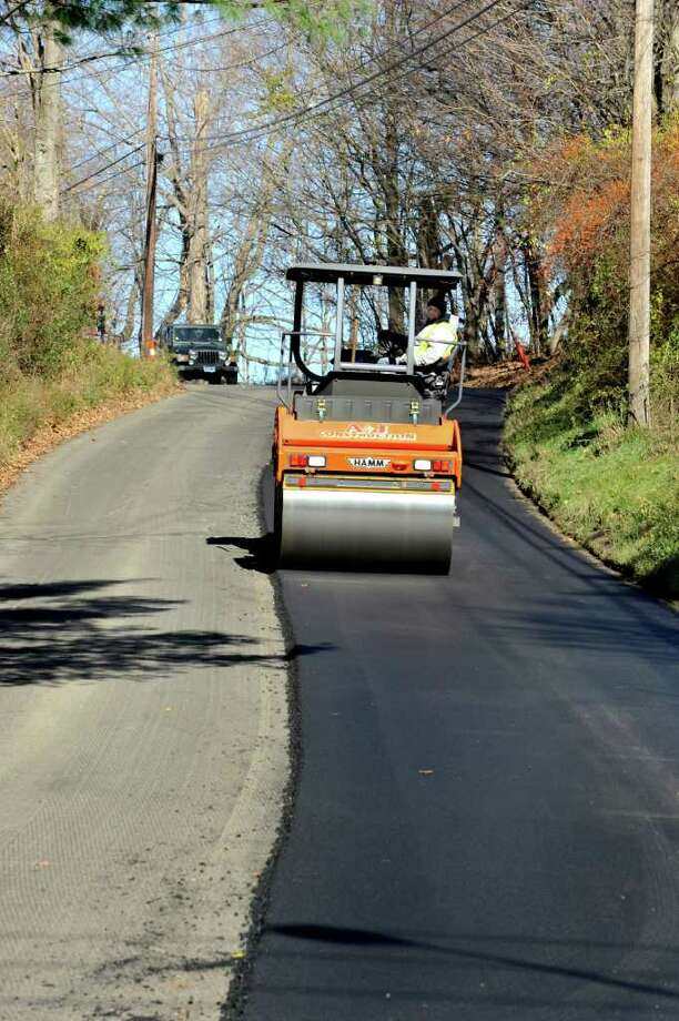 A roller works on Old Hawleyville Road in Bethel, Thursday, Nov. 11, 20109. The project is part of the federal stimulus program. Photo: Michael Duffy / The News-Times