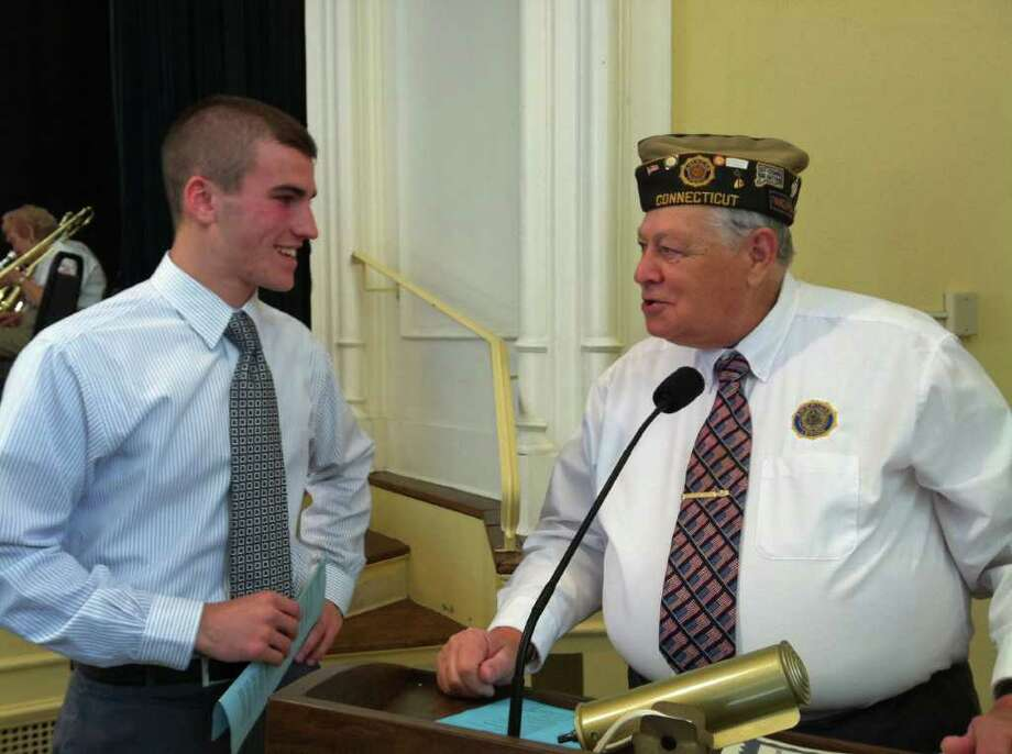 Sean Gallagher, a senior at Staples High School who delivered the the Veterans Day Address at the Town of Westport Veterans Day ceremony on Thursday, Nov. 11, 2010, talks with William Vornkahl, president of the Westport Veterans Council. Photo: Gary Jeanfaivre / Westport News