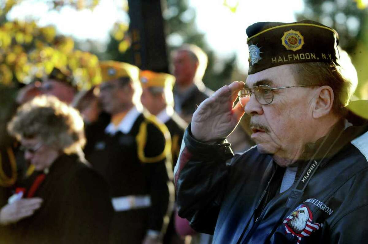 Vietnam veteran Bob Dyer of Halfmoon salutes during the National Anthem during a Veterans Day ceremony to honor veterans of the Iraq War on Thursday, Nov. 11, 2010, at Clifton Park Commons in Clifton Park, N.Y. (Cindy Schultz / Times Union)