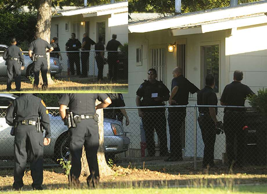 Police officers stand around a home where several police officers were shot while serving a high-risk warrant on Wild Oak Drive on Nov. 11.