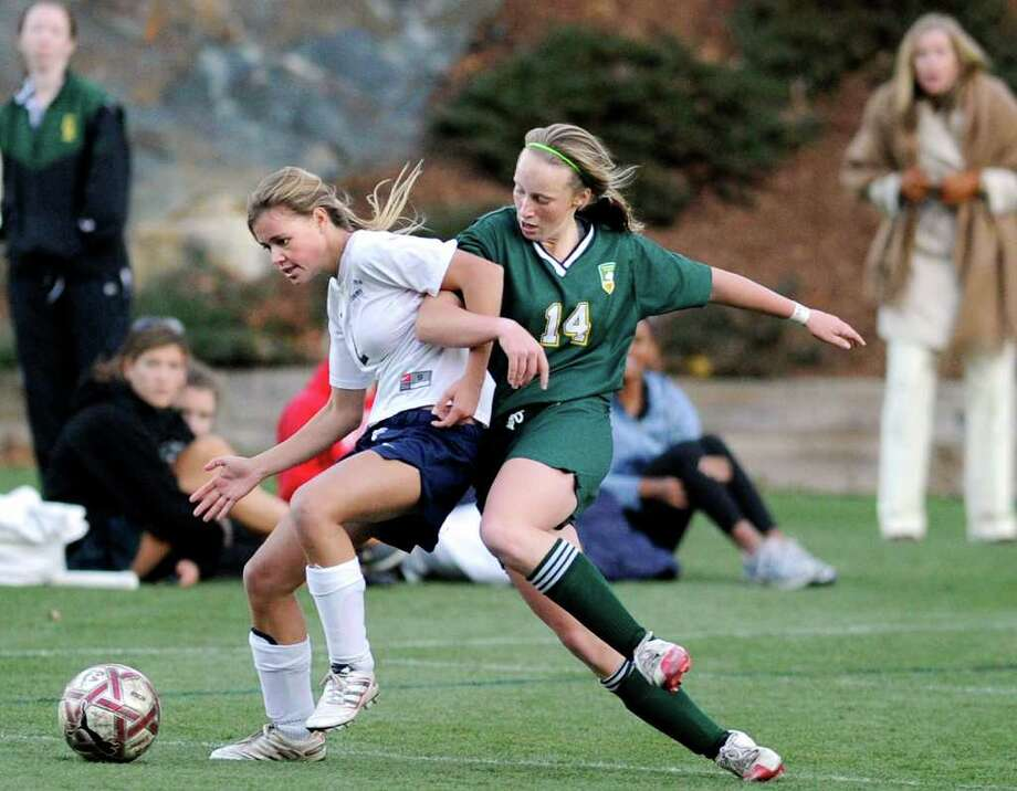 Kathleen Tomlinson, # 2 of GFA, left, mixes it up with Rachel Oates, # 14 of GA, right, during the final minute of regulation time during the  FAA Girls Soccer Championship at Greenwich Academy, which was tied 1-1 but which Greenwich Academy won against Greens Farms Academy of Westport, in a penalty kick shoot-out 3-1, after two scoreless overtimes, Thursday, Nov. 11, 2010. Photo: Bob Luckey / Greenwich Time