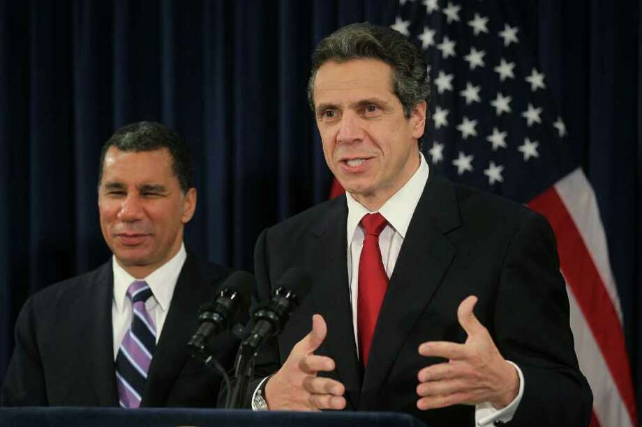 Gov.-elect Andrew Cuomo, right, speaks at a news conference with Gov. David Paterson earlier this week in New York City.  Cuomo is forming his transition team. (Mario Tama/Getty Images) Photo: Mario Tama / 2010 Getty Images