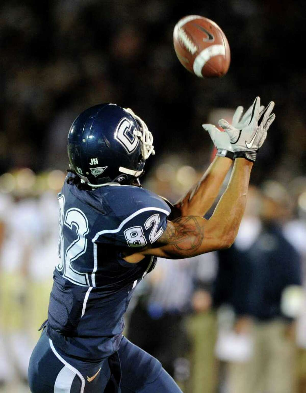 Connecticut's Kashif Moore reaches for a touchdown reception during the first quarter of his team's NCAA college ootball game against Pittsburgh in East Hartford, Conn., on Thursday, Nov. 11, 2010. (AP Photo/Fred Beckham)