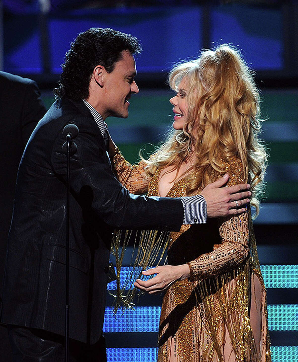 LAS VEGAS - NOVEMBER 11: Pedro Fernandez accepts the Best Regional Mexican Song from Charo onstage during the 11th annual Latin GRAMMY Awards at the Mandalay Bay Events Center on November 11, 2010 in Las Vegas, Nevada. (Photo by Kevin Winter/Getty Images for LARAS) *** Local Caption *** Charo;Pedro Fernandez