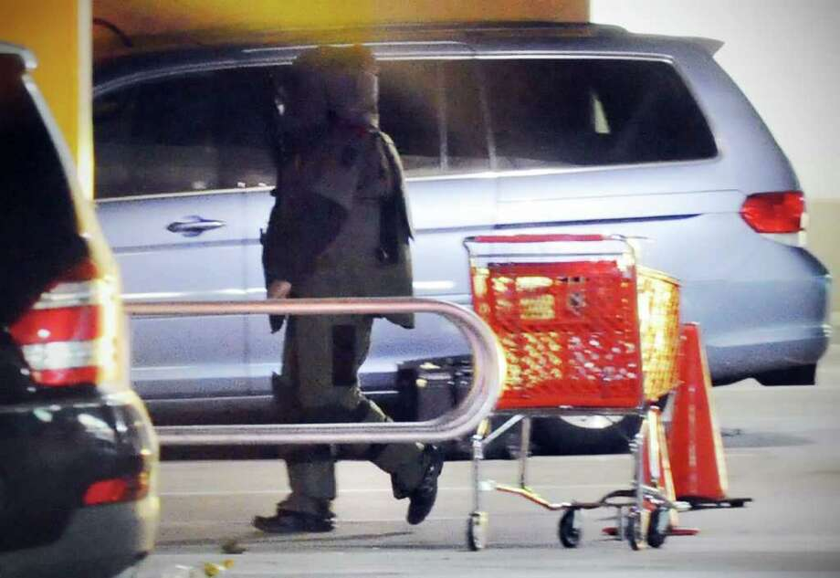The Stamford Police Bomb Squad investigates a suspicious package in the Target parking lot in Stamford, Conn., November 11, 2010. Photo: Keelin Daly / Stamford Advocate