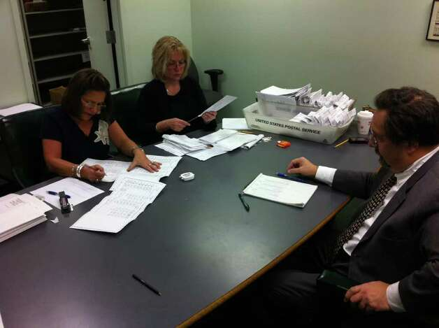 Elections officials count ballots in the race between  Assemblyman Bob Reilly and challenger Jennifer Whalen. Reilly won by 542 votes. (Will Waldron / Times Union)