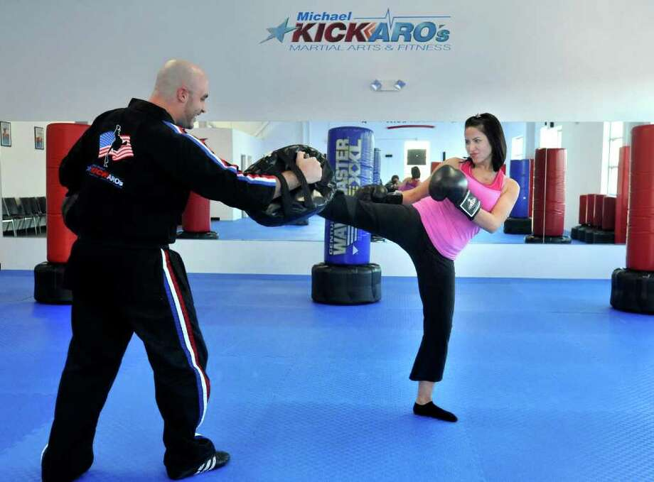 Michael Coccaro, owner of Michael Kickaro's Martial Arts and Fitness, trains kickboxer Erin Bryant, of Brookfield, in his new Danbury location, Thursday, Nov. 11, 2010. Photo: Michael Duffy / The News-Times