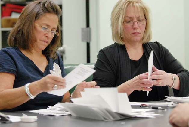 Election officials, Maryann McDermott, left, and Ellen Graziano, right, count absentee ballots in the 109th Assembly District race at the Albany County Board of Elections office in Albany Friday morning. Incumbent Democrat Assemblyman Bob Reilly later claimed victory over Republican Jennifer Whalen in the 109th Assembly District race. (Will Waldron / Times Union) Photo: Will Waldron