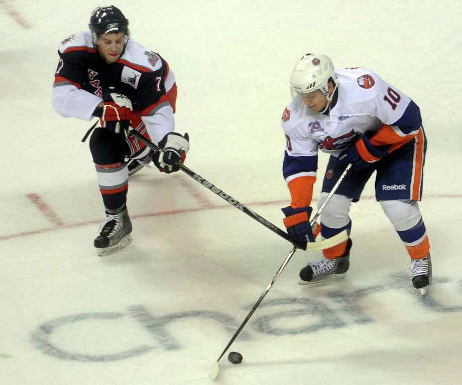 Sountiger Rhett Rakhshani and Hartford's Lee Baldwin compete for control of the puck during Saturday's game against the Hartford Wolf Pack at the Arena at Harbor Yard on November 6, 2010. Photo: Lindsay Niegelberg / Connecticut Post