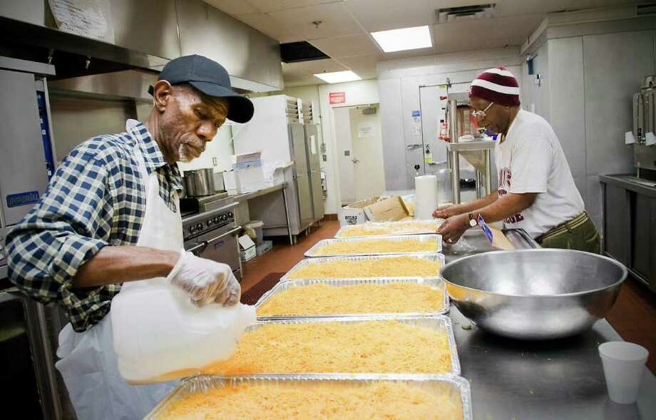 "Curtis Miller and Bob King help prepare food for the 2nd Annual Partnership Community Service Project.  The volunteers from ""100 Black Men of Stamford, Union Baptist Church & Stamford-Norwalk ""Jack and Jill"" gathered at Union Memorial Church in Stamford, Conn. on Friday November 12, 2010 Photo: Kathleen O'Rourke / Stamford Advocate"