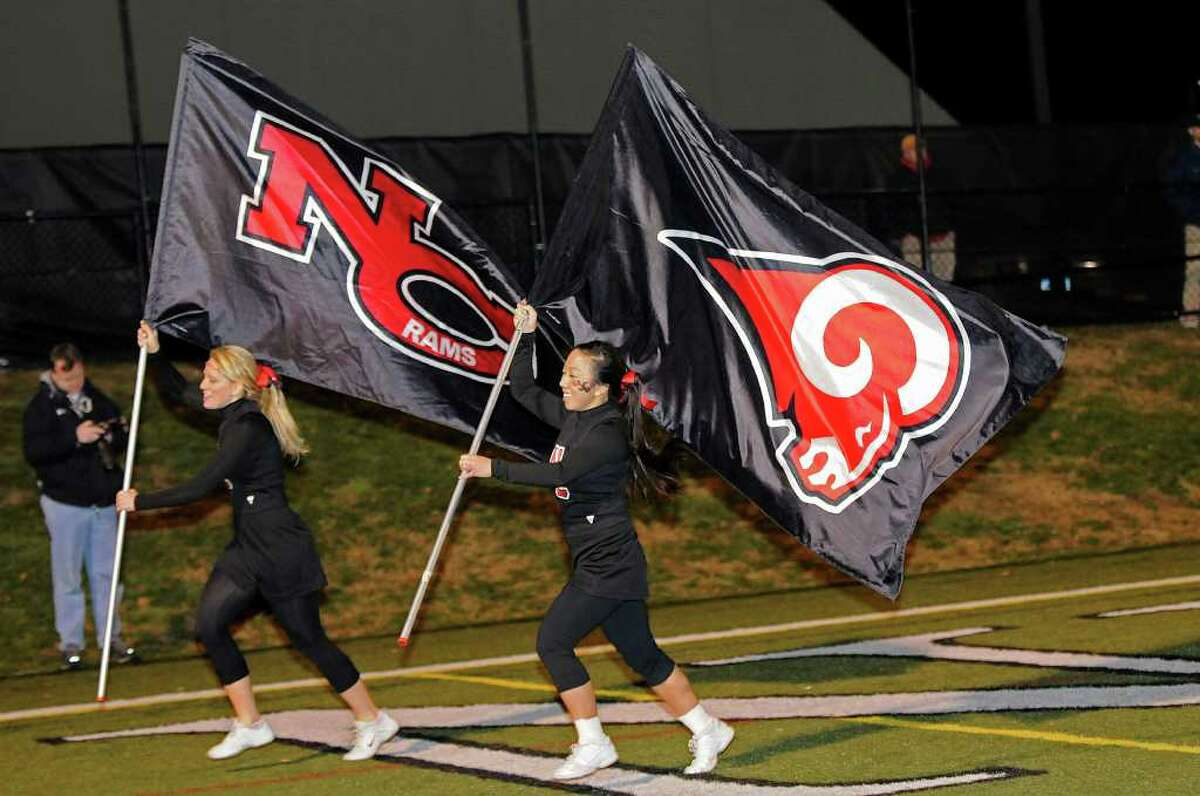New Canaan cheerleading co-captains Elizabeth Checketts (L) and Mel Ng celebrate another New Canaan touchdown as New Canaan High School hosts Central High School in varsity football in New Canaan, Connecticut on Friday, November 12, 2010.