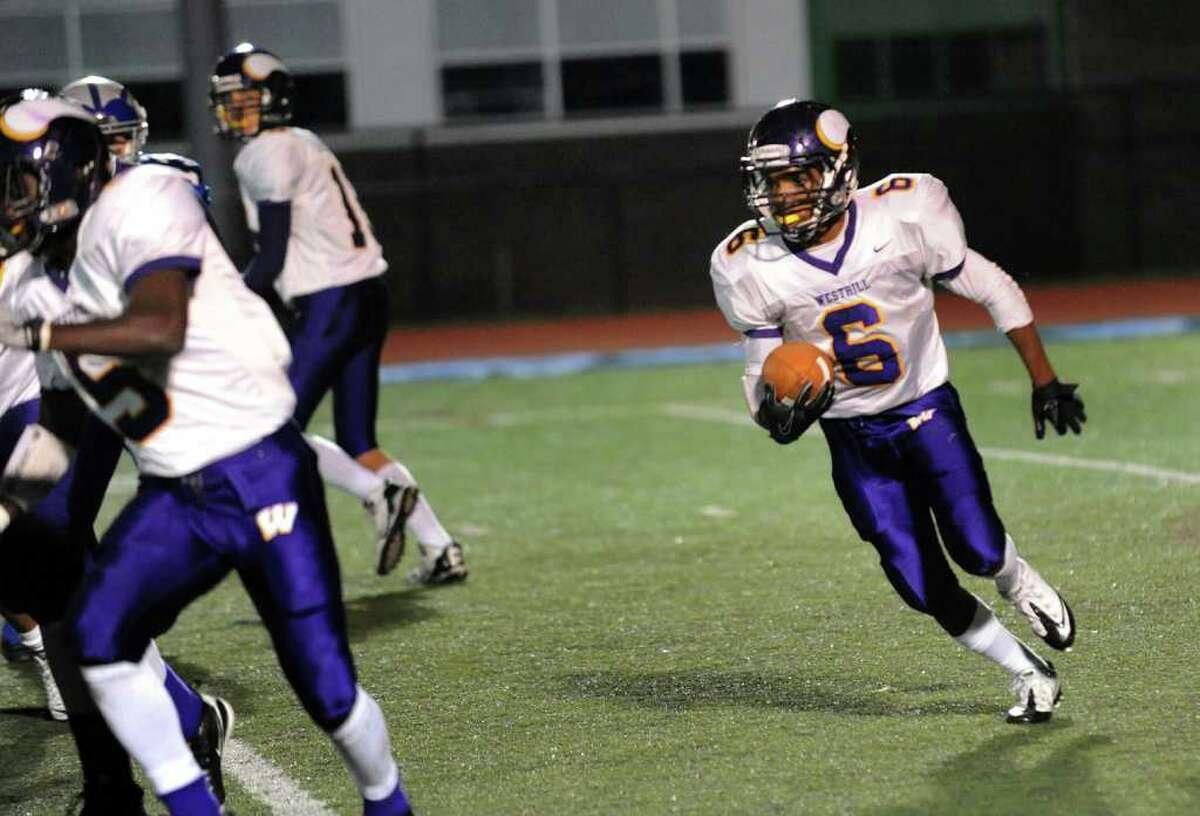 Westhill's #6 Akai Jackson carries the ball, during football action against Fairfield Ludlowe in Fairfield, Conn. on Friday November 12, 2010.