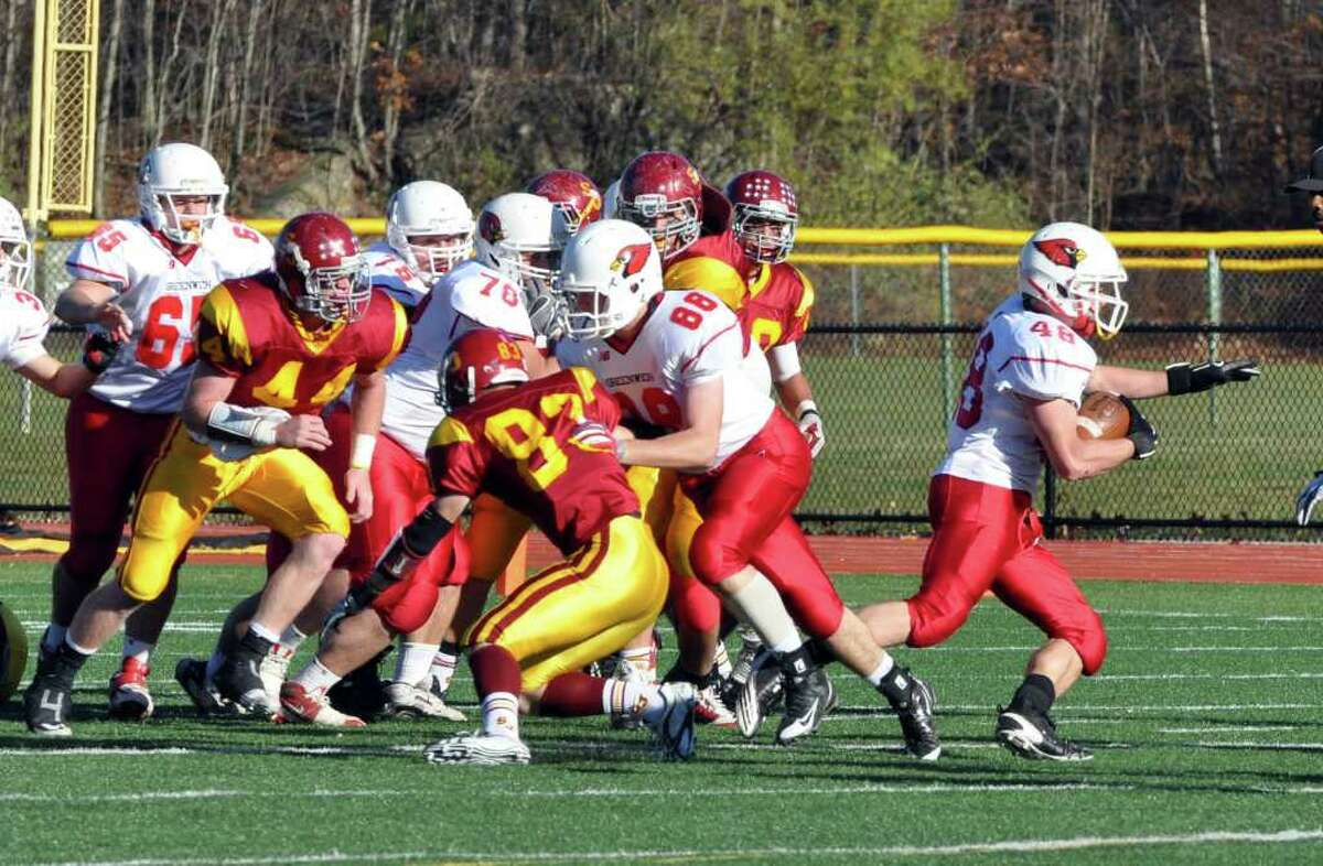 Greenwich's Shane Nashtahowski slips past a host of St. Joseph defenders during the football game at St. Joseph in Trumbull on Saturday, Nov. 13, 2010.