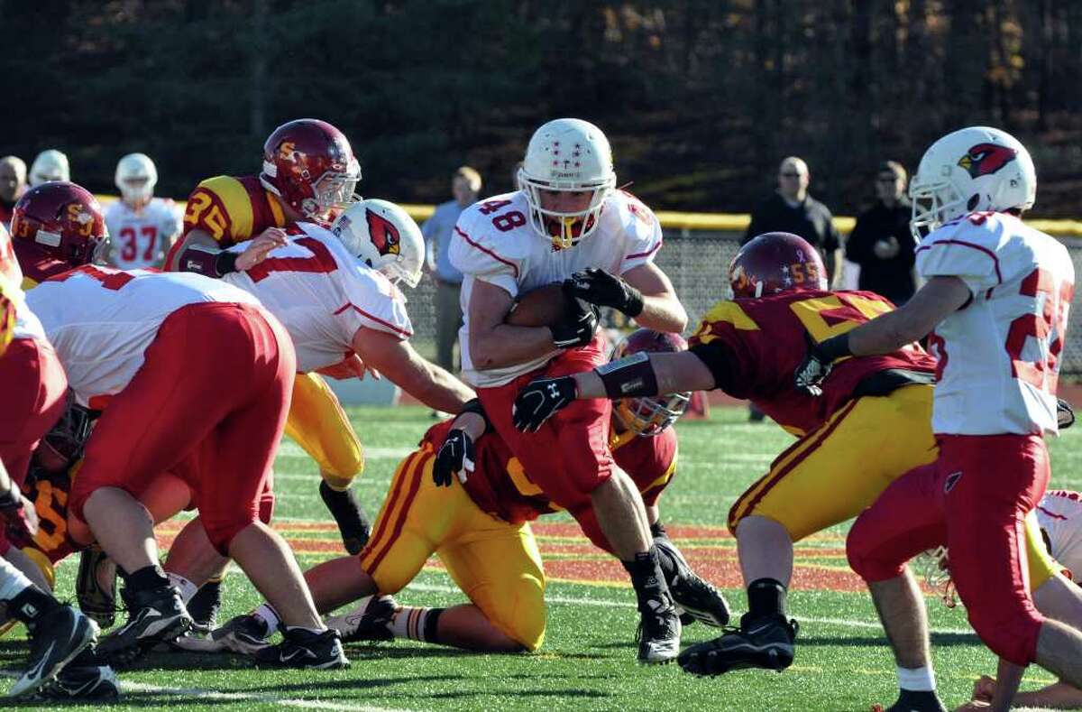 Greenwich's Shane Nashtahowski plows through St. Joseph defenders during the football game at St. Joseph in Trumbull on Saturday, Nov. 13, 2010.