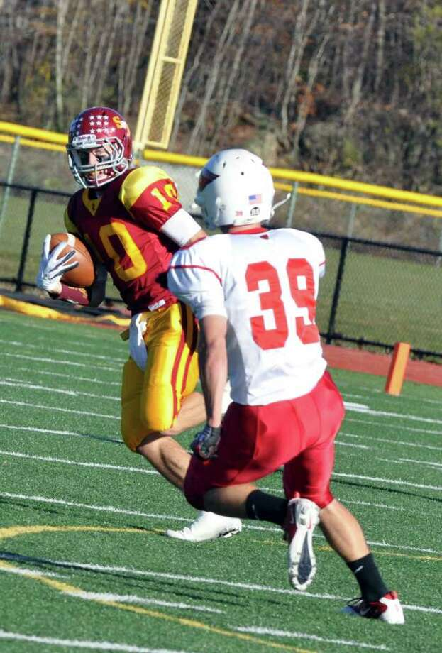 St. Joseph's Pat Mulligan carries an interception as Greenwich's Mike Daly defends during the football game at St. Joseph in Trumbull on Saturday, Nov. 13, 2010. Photo: Amy Mortensen / Connecticut Post Freelance