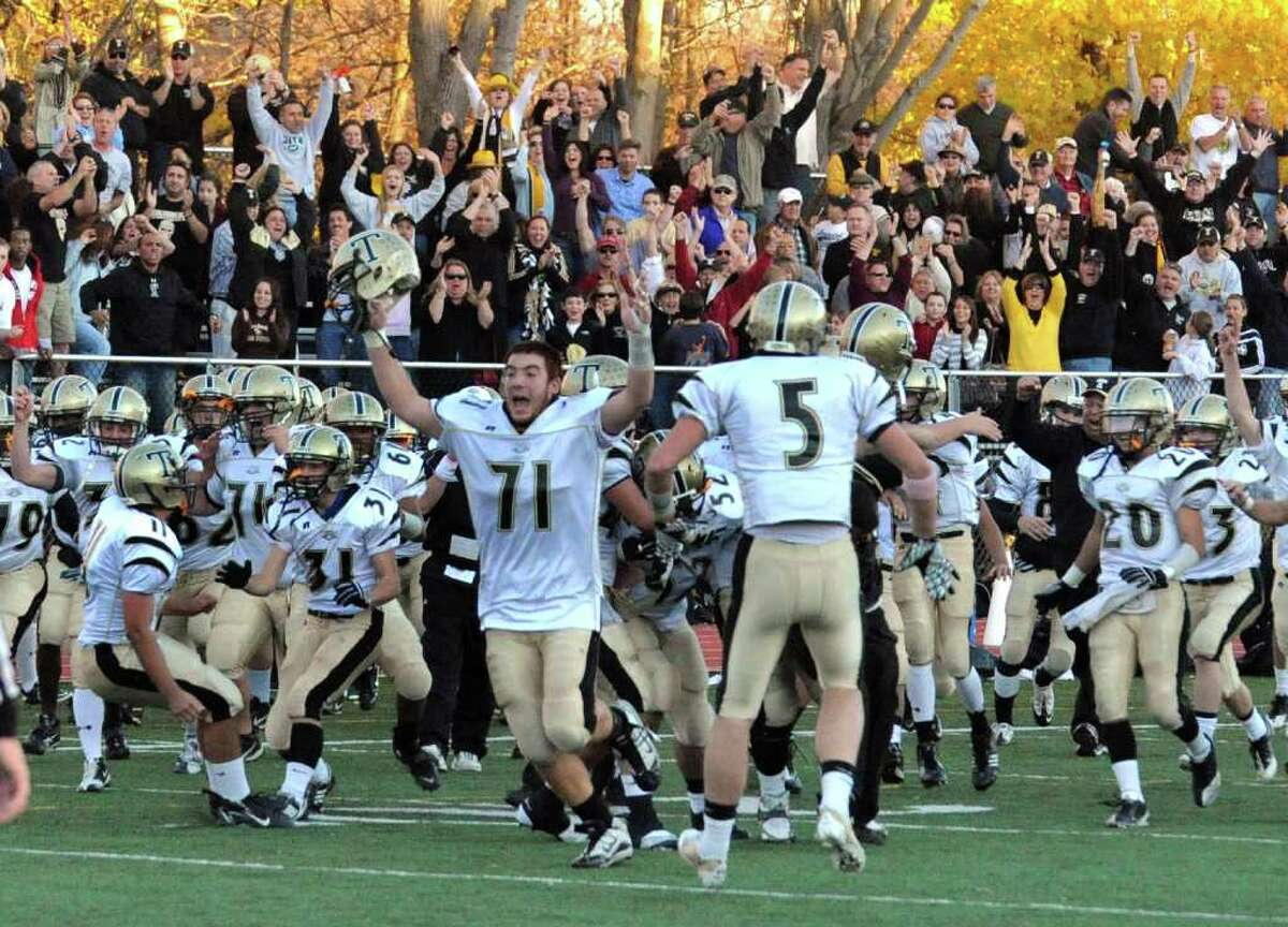 Grant Roman and Trumbull celebrate their win over Staples 15-13, during football action in Westport, Conn. on Saturday November 13, 2010.