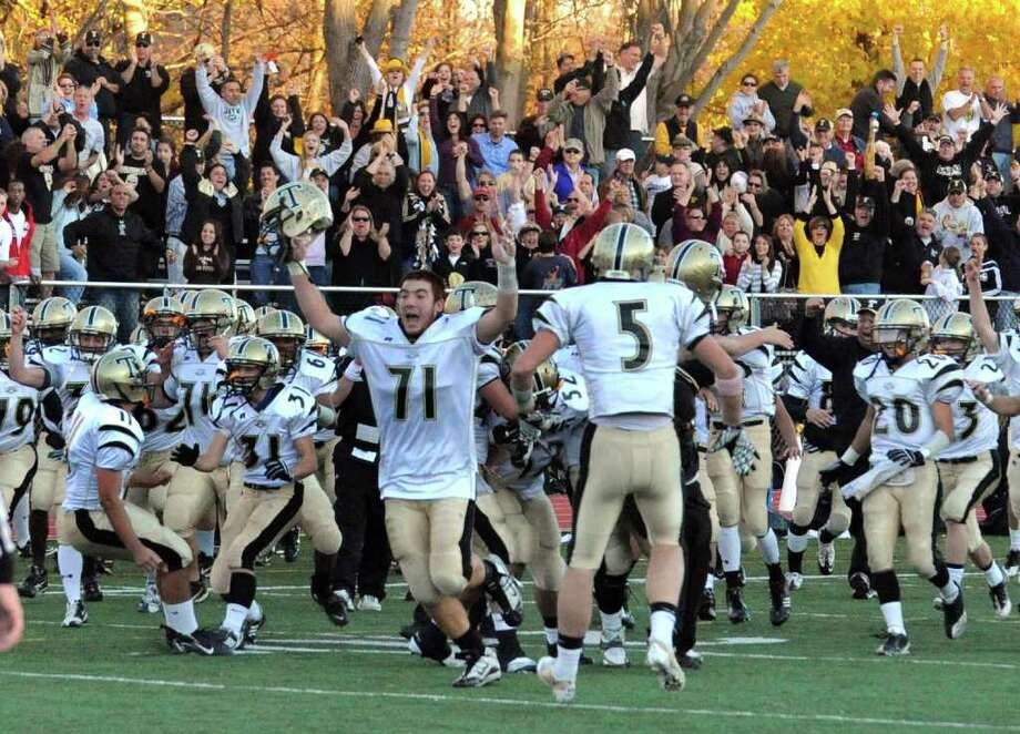 Grant Roman and Trumbull celebrate their win over Staples 15-13, during football action in Westport, Conn. on Saturday November 13, 2010. Photo: Christian Abraham / Connecticut Post
