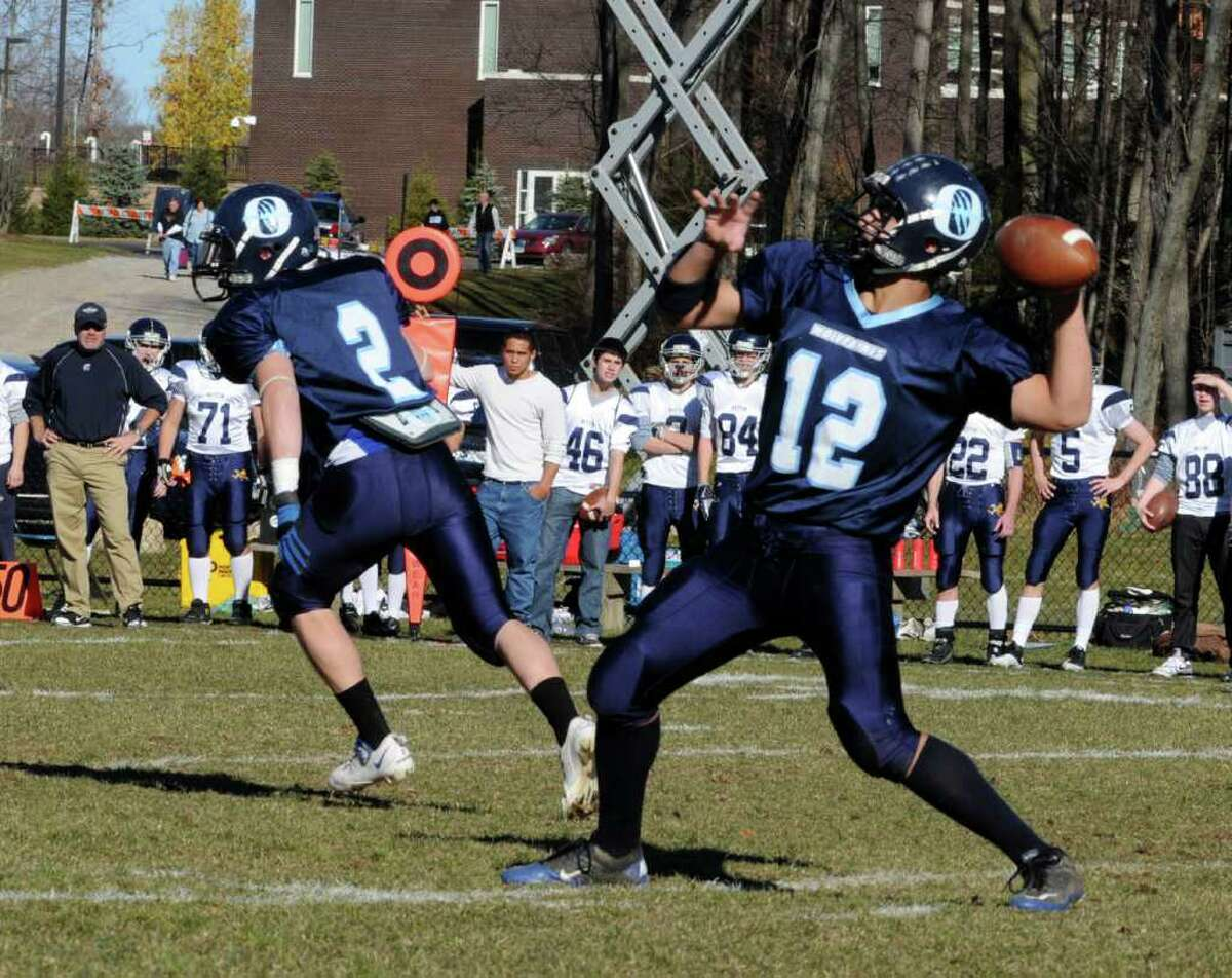 Oxford's #12 Brennen Diaz looks to through a pass against Weston at Oxford High School on Sat. Nov. 13, 2010.