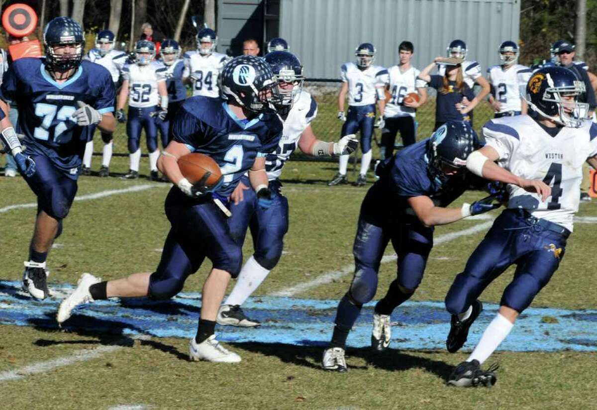 Oxford's #2 Nick Donofrio carries the ball against Weston during Saturdays game at Oxford High School. Nov. 13, 2010.