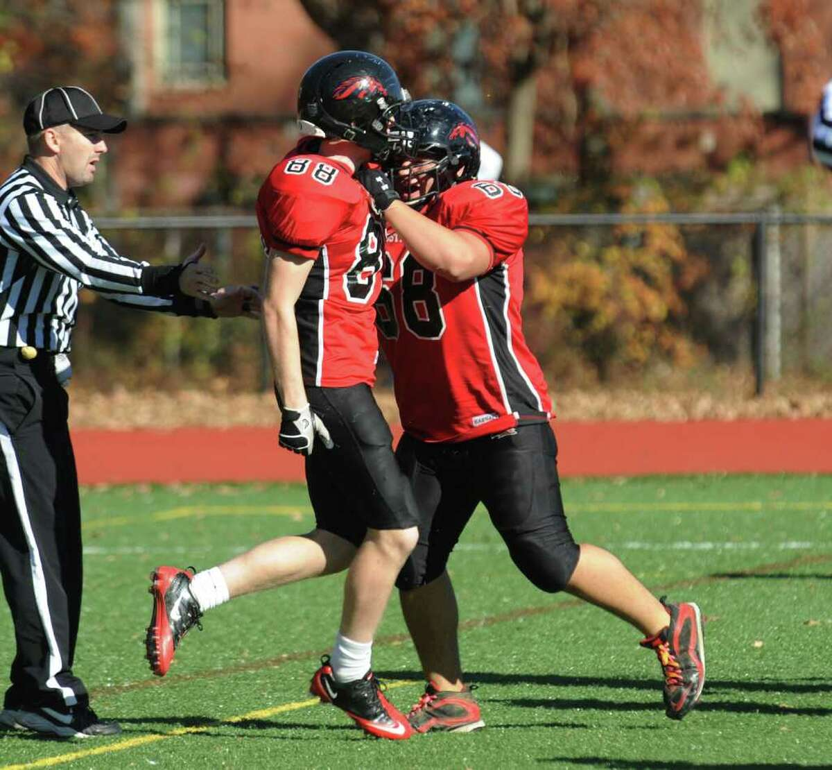 Fairfield Warde's #88 Kevin Sullivan, left, celebrates with a teammate after scoring a touchdown, during football action against Danbury in Fairfield, Conn. on Saturday November 13, 2010.