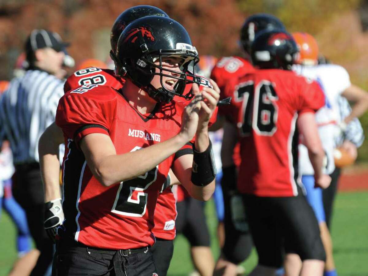 Fairfield Warde's QB Chris Foley claps after #88 Kevin Sullivan scored a touchdown, during football action against Danbury in Fairfield, Conn. on Saturday November 13, 2010.