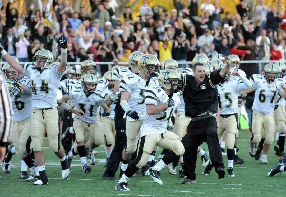 Trumbull celebrates their win over Staples 15-13, during football action in Westport, Conn. on Saturday November 13, 2010. Photo: Christian Abraham / Connecticut Post