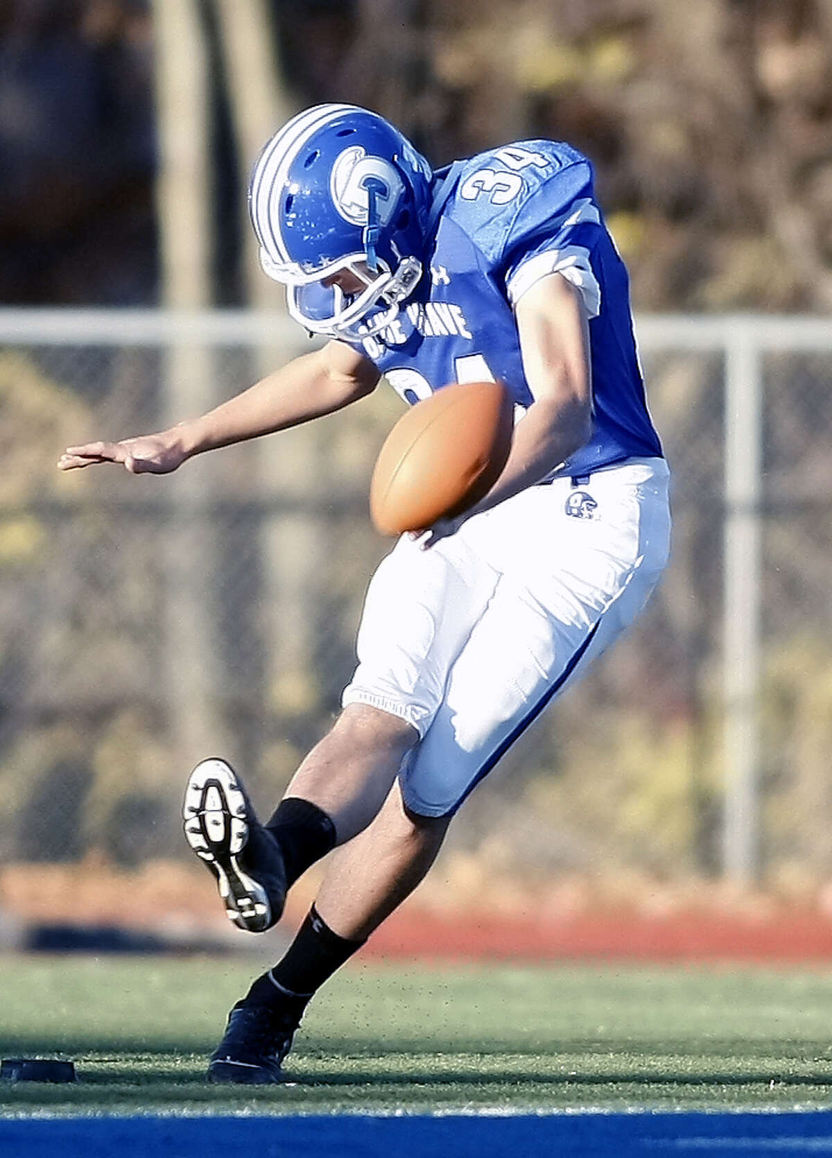 Tommy Dimauro, kicks the ball for the punt team after a blue Wave score as Darien hosts Norwalk High on Saturday, November, 13th in Darien, Conn.