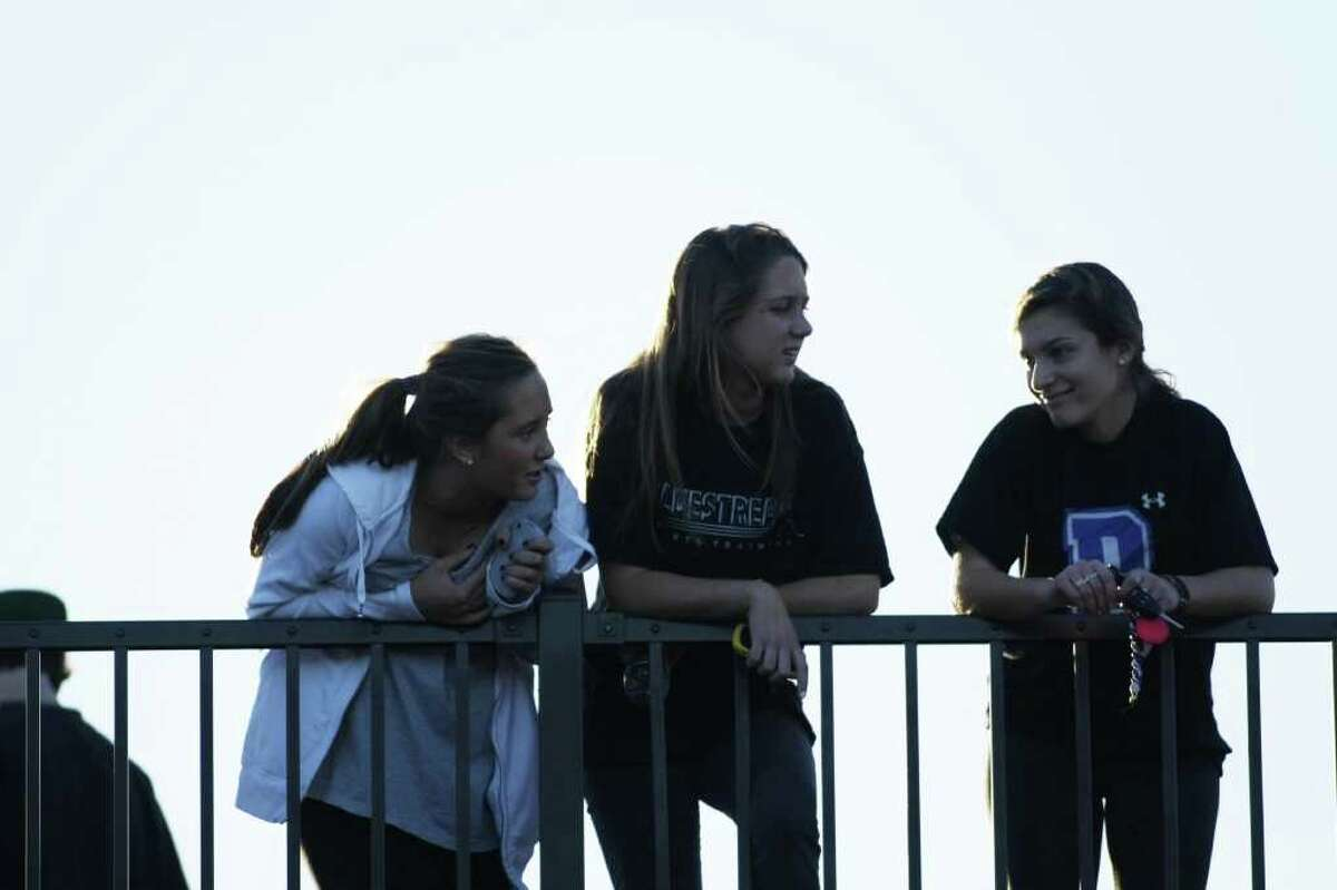 Darien fans look on from the upper balcony as The Blue Wave hosts Norwalk on Saturday, November 13th in Darien, Conn.