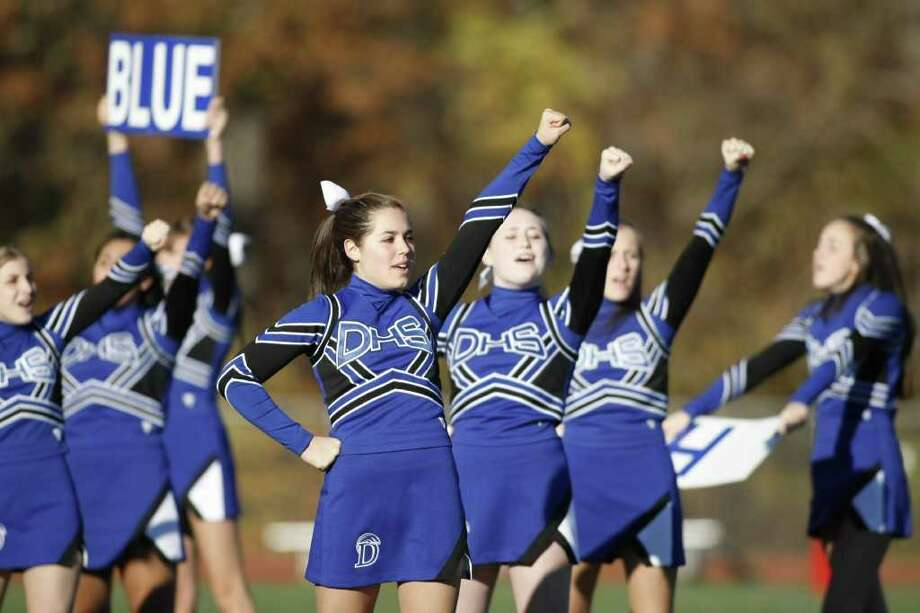 The Darien Cheerleaders do a cheer at the half as The Blue Wave hosts Norwalk on Saturday, November 13th in Darien, Conn. Photo: David E. Johnston / Connecticut Post Freelance