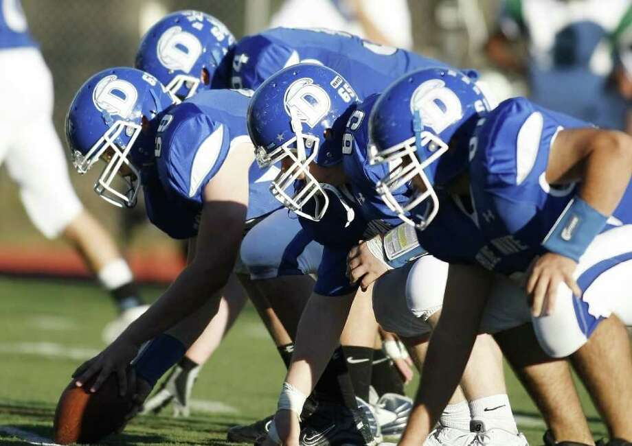 The Darien Offensive line dominated the game as The blue Wave hosts The Norwalk Bears on Saturday, November 13th in Darien, Conn. Photo: David E. Johnston / Connecticut Post Freelance