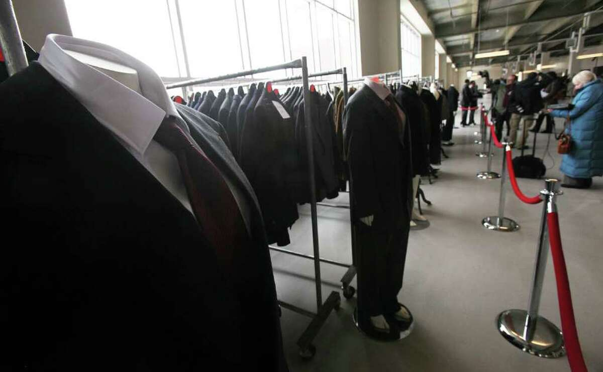 NEW YORK - NOVEMBER 10: Suits are displayed at a press preview of an auction of 400 pieces of personal property, jewelry, and antiques from Bernard and Ruth Madoff November 10, 2010 in the Brooklyn borough of New York City. The United States Marshals Service will conduct the auction of property seized in connection with Madoff's criminal prosecution and the proceeds will be deposited into a fund compensating victims of the multi-billion dollar fraud. The auction will occur at 10:00 a.m. on November 13, 2010 online and live at the New York Sheraton Hotel and Towers. (Photo by Mario Tama/Getty Images)