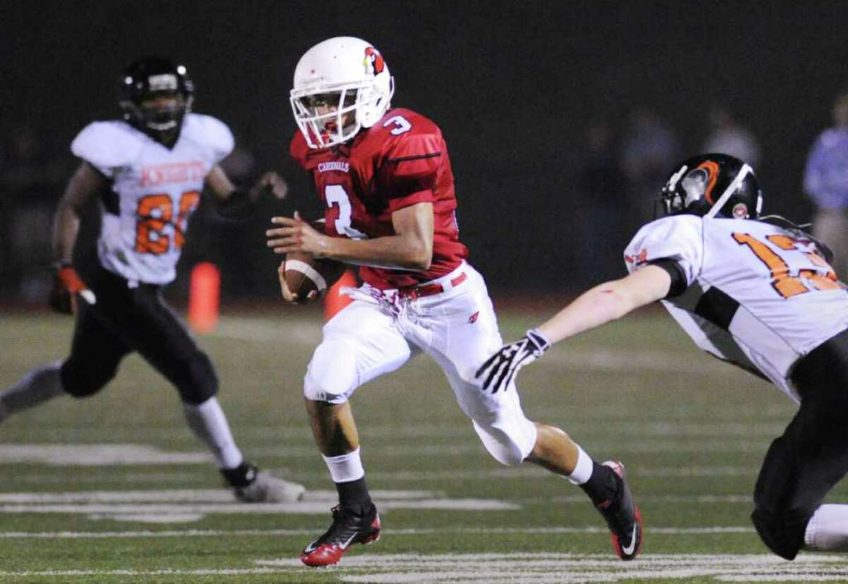 Joel Arroyo, # 3 of the Greenwich High School football team breaks it upfield during a running play as Chandler Foster, # 13 of the Stamford High School football team, right, attempts a tackle, Friday night, Sept. 24, 2010 at GHS. 9/25/10 GT photo (chopped) = Bouncing Back. Return to Wing-T effective. by Jesse Quinlan. (Story on Pg. B1) 10/2/10 GT photo = Greenwich Travels to Harding. Poised for a breakout. by Jesse Quinlan