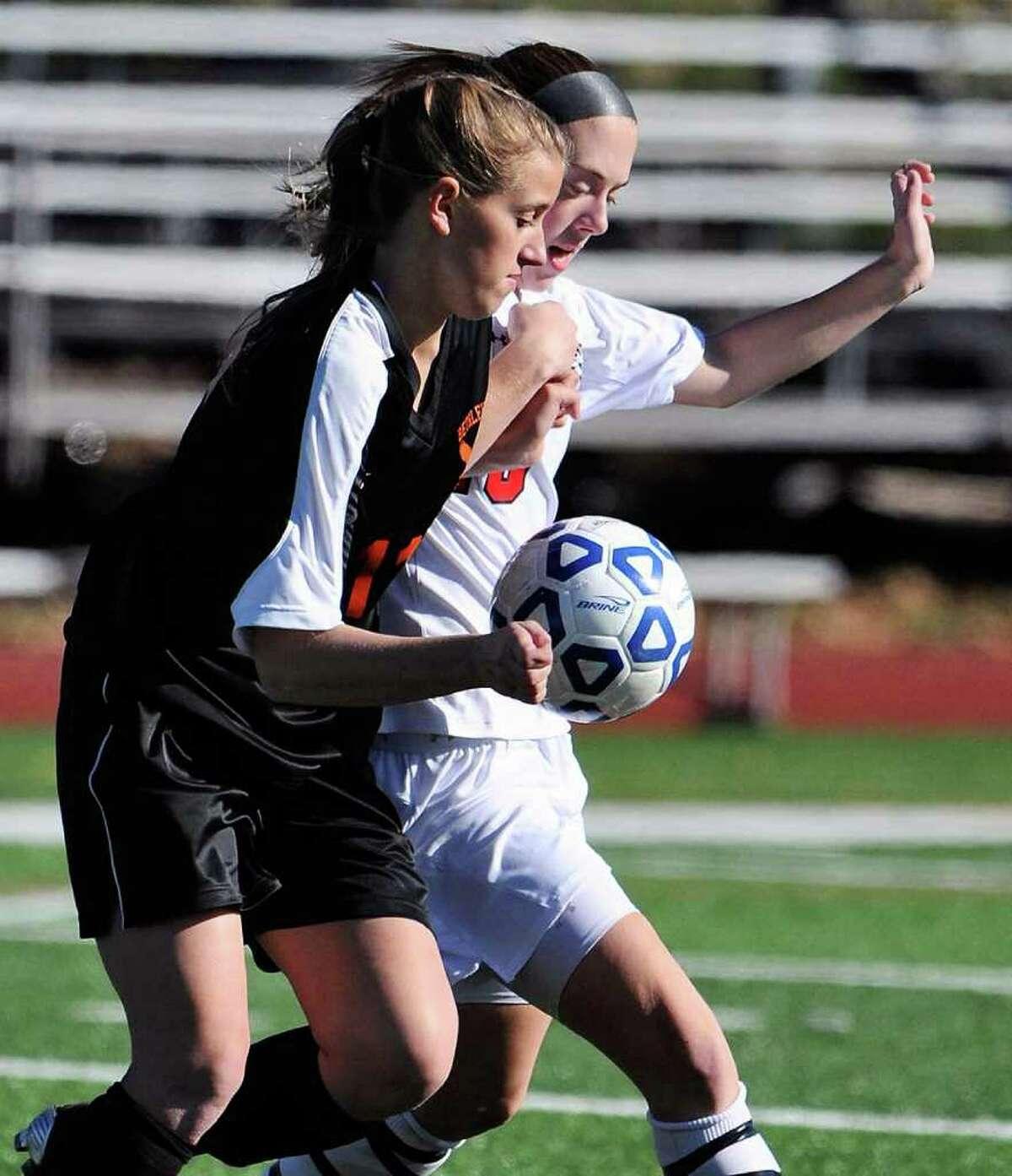High school soccer -- Baldwinsville's Clair Monnat, in back, battles for the ball against Bethlehem's Tara Teal. (Nicholas Lisi / The Post-Standard)