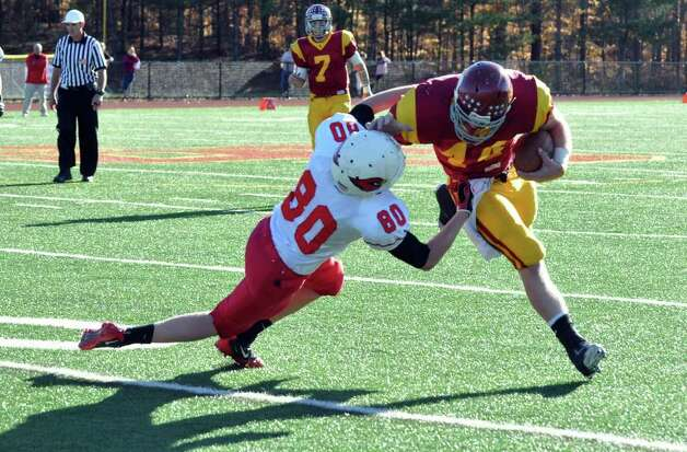 Greenwich's Joe Kelly attempts to take down St. Joseph's Tyler Matakevich during the football game at St. Joseph in Trumbull on Saturday, Nov. 13, 2010. Photo: Amy Mortensen / Connecticut Post Freelance