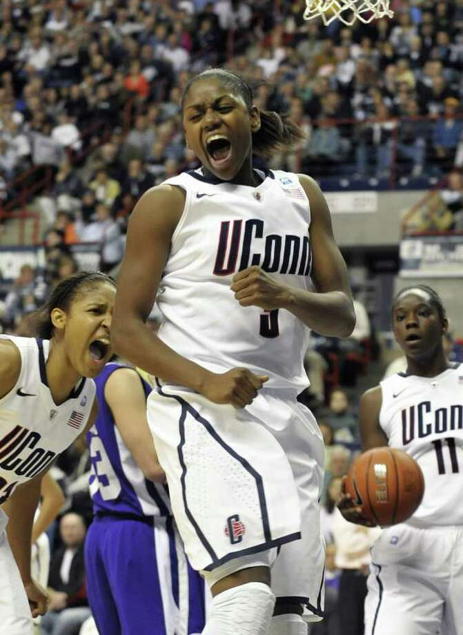 Connecticut's Tiffany Hayes celebrates after making a basket and being fouled by a  Holy Cross player during the first half of a NCAA college basketball game, in Storrs, Conn., Sunday, Nov. 14, 2010. Hayes had 30 points in the first half. (AP Photo/Jessica Hill) Photo: Jessica Hill, AP / AP2010
