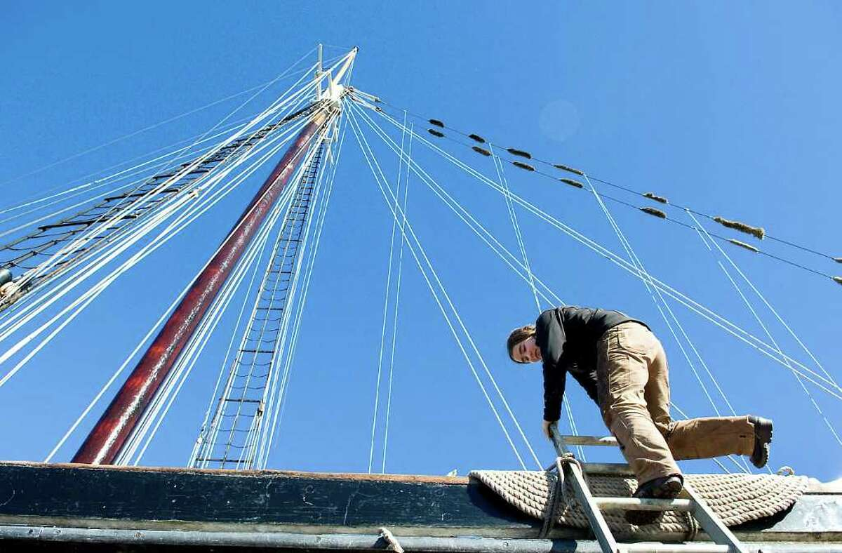 Aleythea Dolstad climbs down from the 106-foot long Clearwater at Norwalk Cove Marina in Norwalk, Conn. on Friday November 12, 2010. The crew is working on the ship and giving her wooden hull a fresh coat of bottom paint.