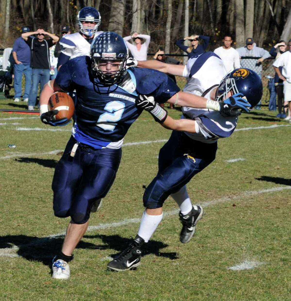 Oxford's #2 Nick Donofrio attempts to break Weston's #34 JD Simmons tackle during a game at Oxford High School on Sat. Nov. 13, 2010.
