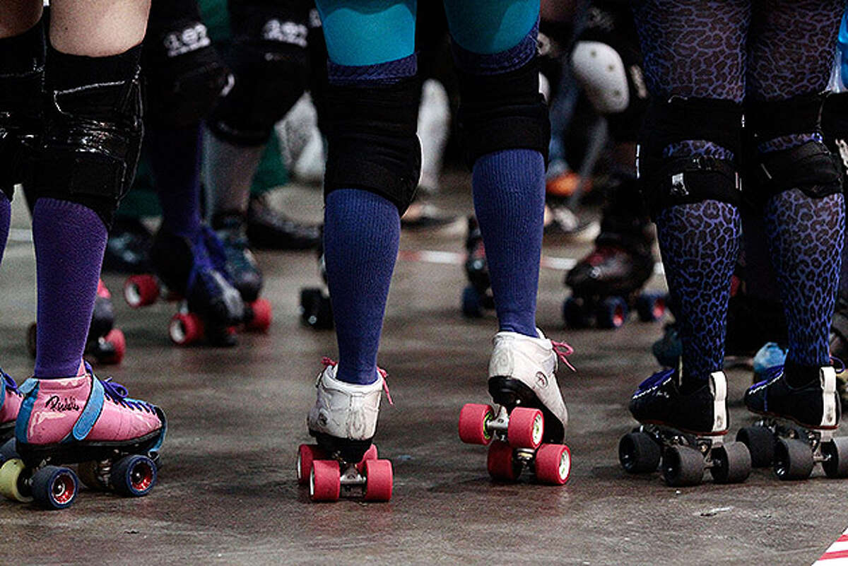LONDON, ENGLAND - NOVEMBER 13: Competitors warm up at London Rollergirls Roller Derby event at London Earls Court Olympia on November 13, 2010 in London, England. The contact sport of Roller Derby involves two teams of four defensive players and one jammer, whose role it is to pass through the pack to count a score. (Photo by Matthew Lloyd/Getty Images)