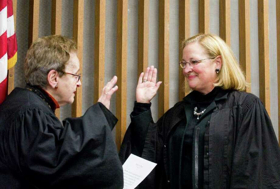 Judge Frederica Brenneman, left, reinstates Judge Maureen Dennis as a judge during an oath ceremony in the Norwalk courthouse in Norwalk, Conn., November 14, 2010. Dennis began her career as a public defender in Norwalk. Photo: Keelin Daly / Stamford Advocate