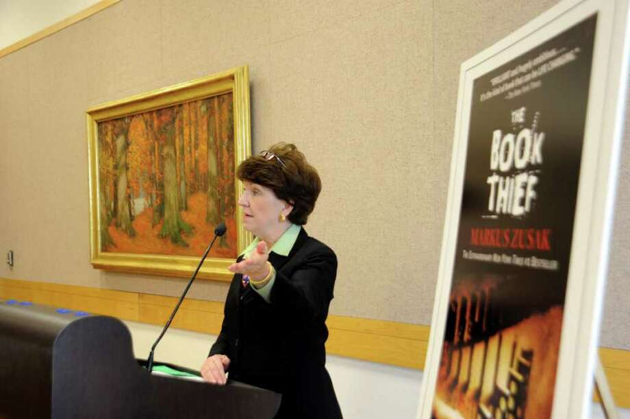 "Carol Mahoney, Greenwich Library director, announces that  ""The Book Thief"" by Markus Zusak, is the book chosen by the community for Greenwich Reads Together, a community-wide reading experience which will engage all of Greenwich in exploring a single book, at the Greenwich Library, on Monday, Nov. 15, 2010 Photo: Helen Neafsey / Greenwich Time"