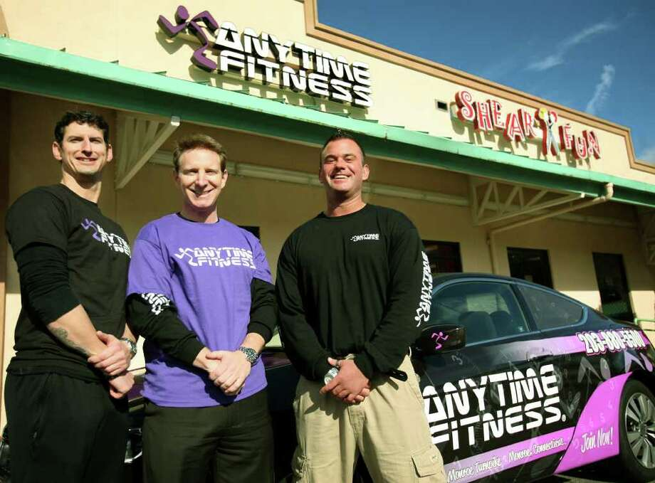 From left; Master trainer Jeremey Kent, owner Marc Kirshner, and managing partner Chris Platt at the new 24-hour Anytime Fitness at 380 Monroe Turnpike in Monroe. Photo: Brian A. Pounds / Connecticut Post