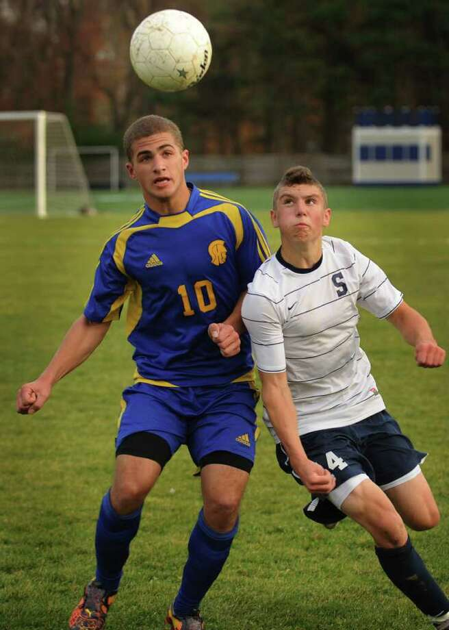 Simsbury's Shane Arena, left, and Staples' Mikey Scott position to play a header during the Wreckers' 1-0 victory in the Class LL quarterfinals at Staples High School in Westport on Monday, November 15, 2010. Photo: Brian A. Pounds / Connecticut Post