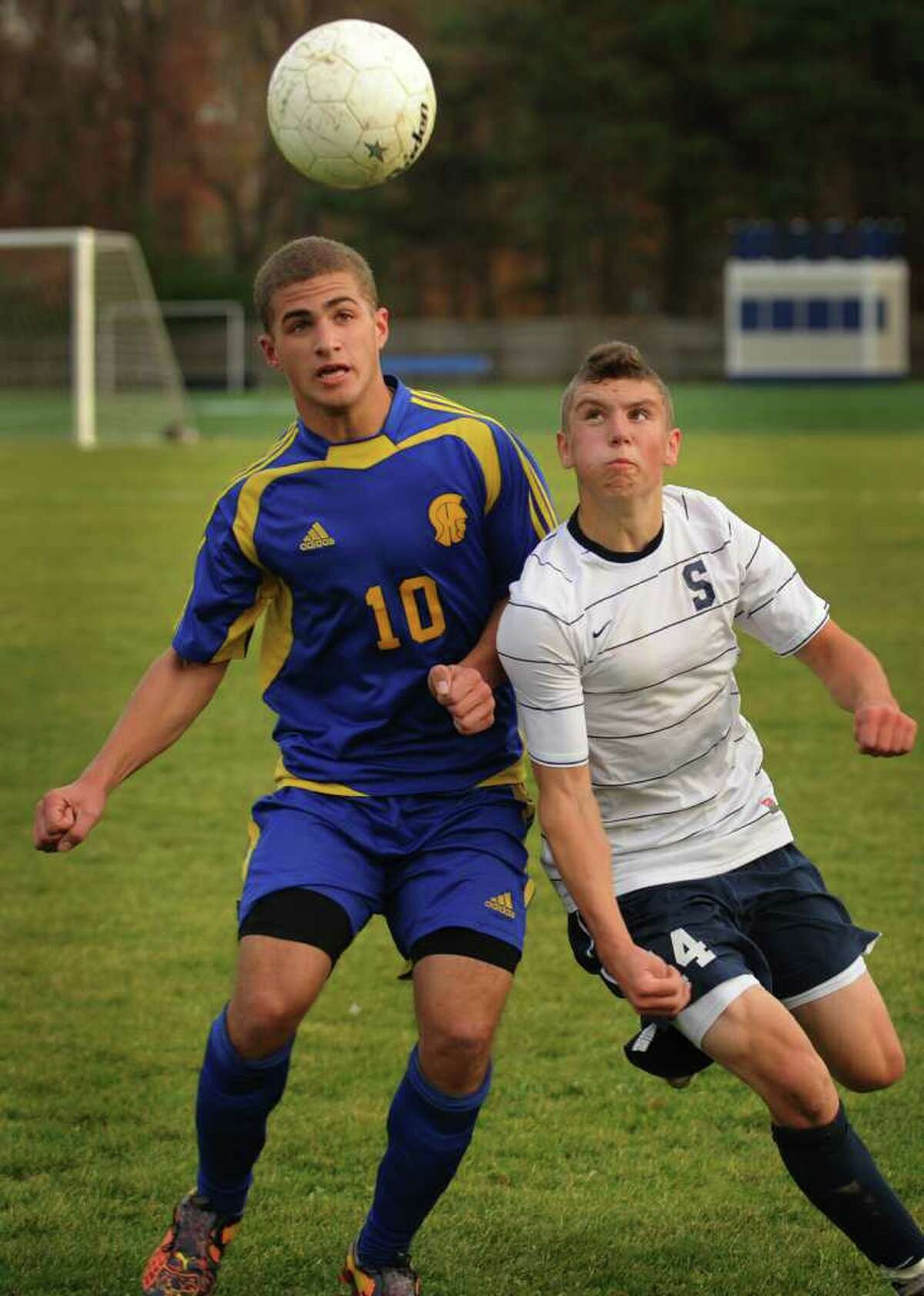 Simsbury's Shane Arena, left, and Staples' Mikey Scott position to play a header during the Wreckers' 1-0 victory in the Class LL quarterfinals at Staples High School in Westport on Monday, November 15, 2010.