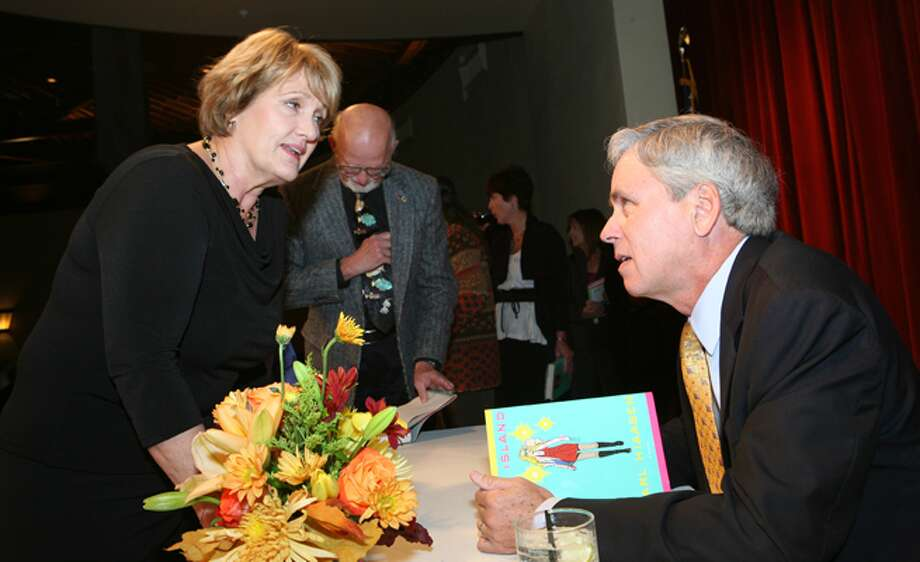 Ann Young talks with novelist and Miami Herald columnist Carl Hiaasen at the San Antonio Public Library Foundation's Copyright Texas fundraiser dinner at Pearl Stable.