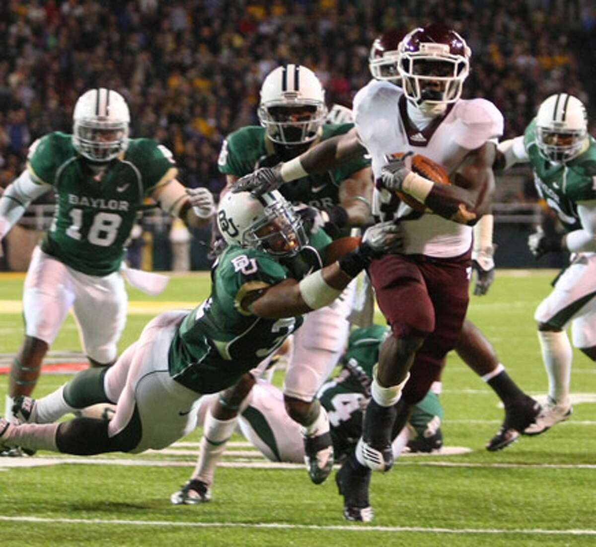 Texas A&M running back Cyrus Gray (right) scores one of his four touchdowns against Baylor and defender Chris McAllister.