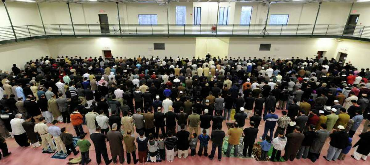 Worshippers gather Tuesday morning at the Islamic Center in Colonie for eid prayers to celebrate the annual pilgrimage (called hajj) to Mecca that every Muslim is exepcted to make at least once. (Skip Dickstein/Times Union)